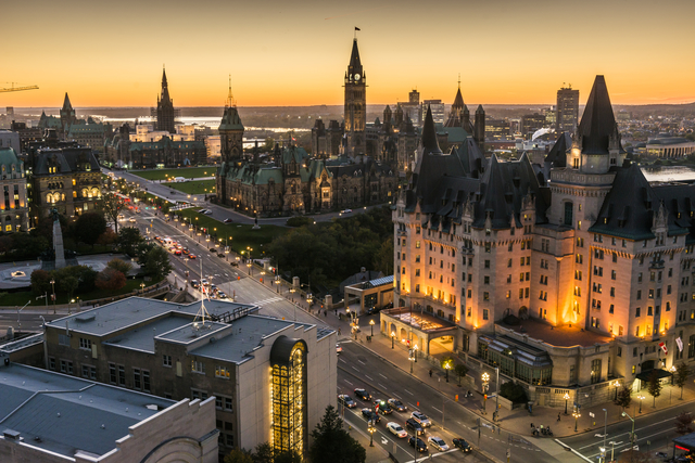 Panoramic view of downtown Ottawa with Parliament Hill, Fairmont Château Laurier and Government Conference Centre